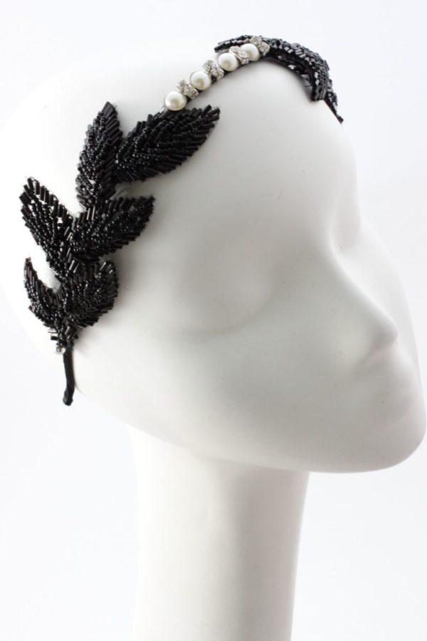 elegancka opaska z czarnymi liśćmi