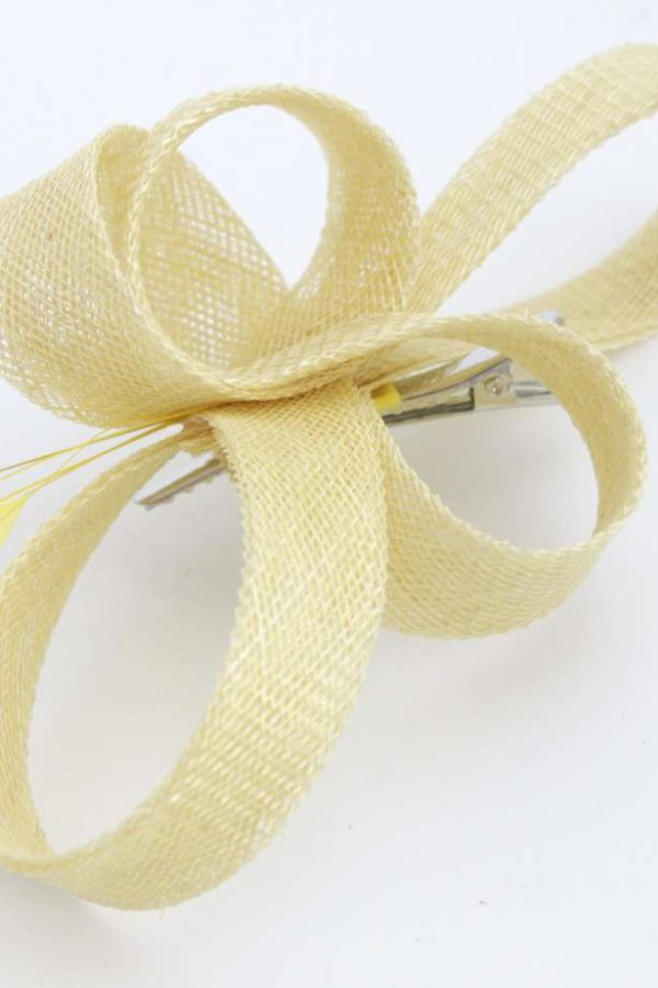 zakręcony żółty fascynator na spince